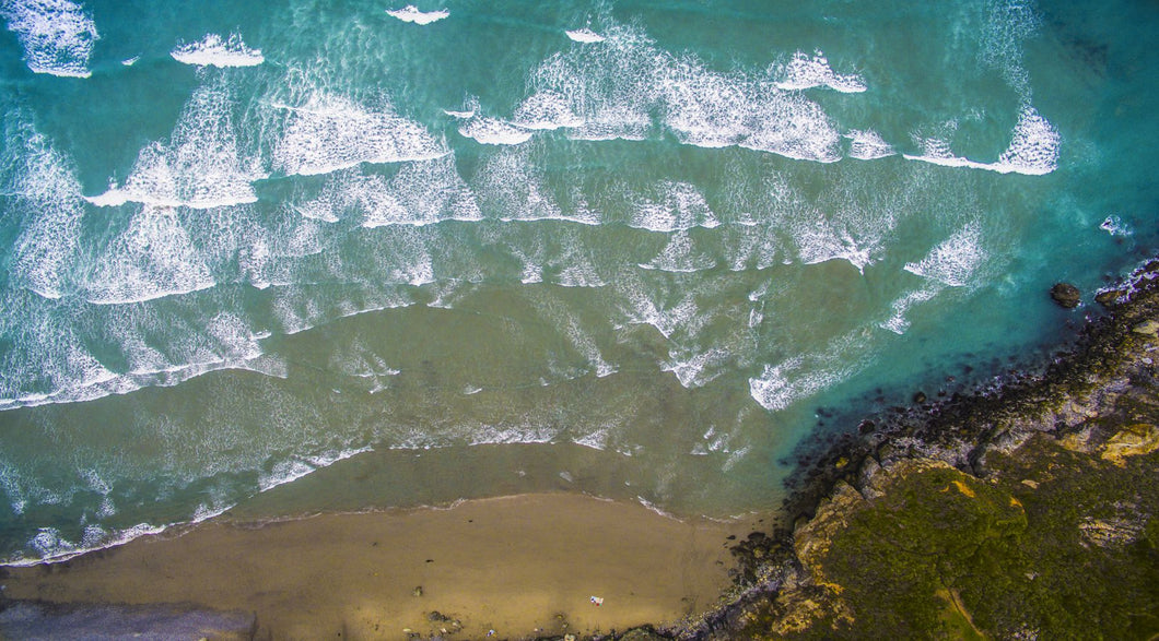 Aerial view of ocean waves on beach, Big Sur, California, USA