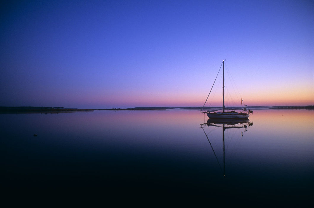 SAILBOAT AT DAWN ON CALM WATER CAMPBELL CREEK NORTHERN CALIFORNIA USA
