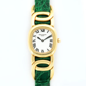 Patek Philippe Ellipse 4830 18k YG  Excellent Ladies 18k YG White 23.12 X 25.55mm Quartz 1990s Green Crocodile (used condition) N/A