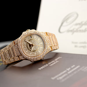 Patek Philippe Nautilus 7011/1R-010 18k RG  Excellent Ladies 18k RG Pave Diamond 32mm Quartz 2010 Rose Gold with Custom Pave Diamonds (6 3/4) Original Box and Certificate