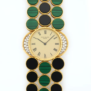 Patek Philippe Vintage 4283/11 18k YG  Mint Ladies 18k YG Champagne with Black Roman Numerals 33mm Manual 1970s Yellow Gold with Black Onyx and Malachite Archive Paper