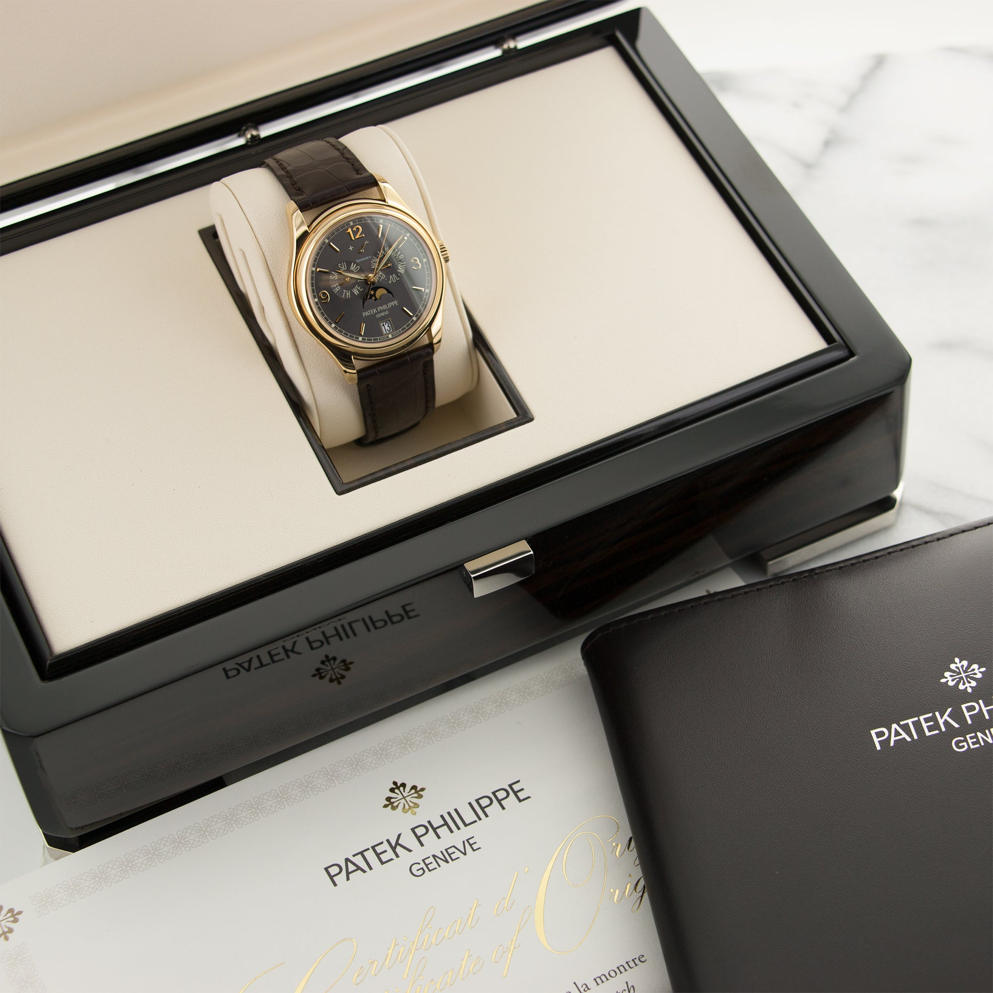 Patek Philippe Annual Calendar 5146J 18k YG  Like New, Worn a Few Times Gents 18k YG Grey with Tiffany & Co. Signature 39mm Automatic 2017 Brown Crocodile Strap Original Box and Certificate