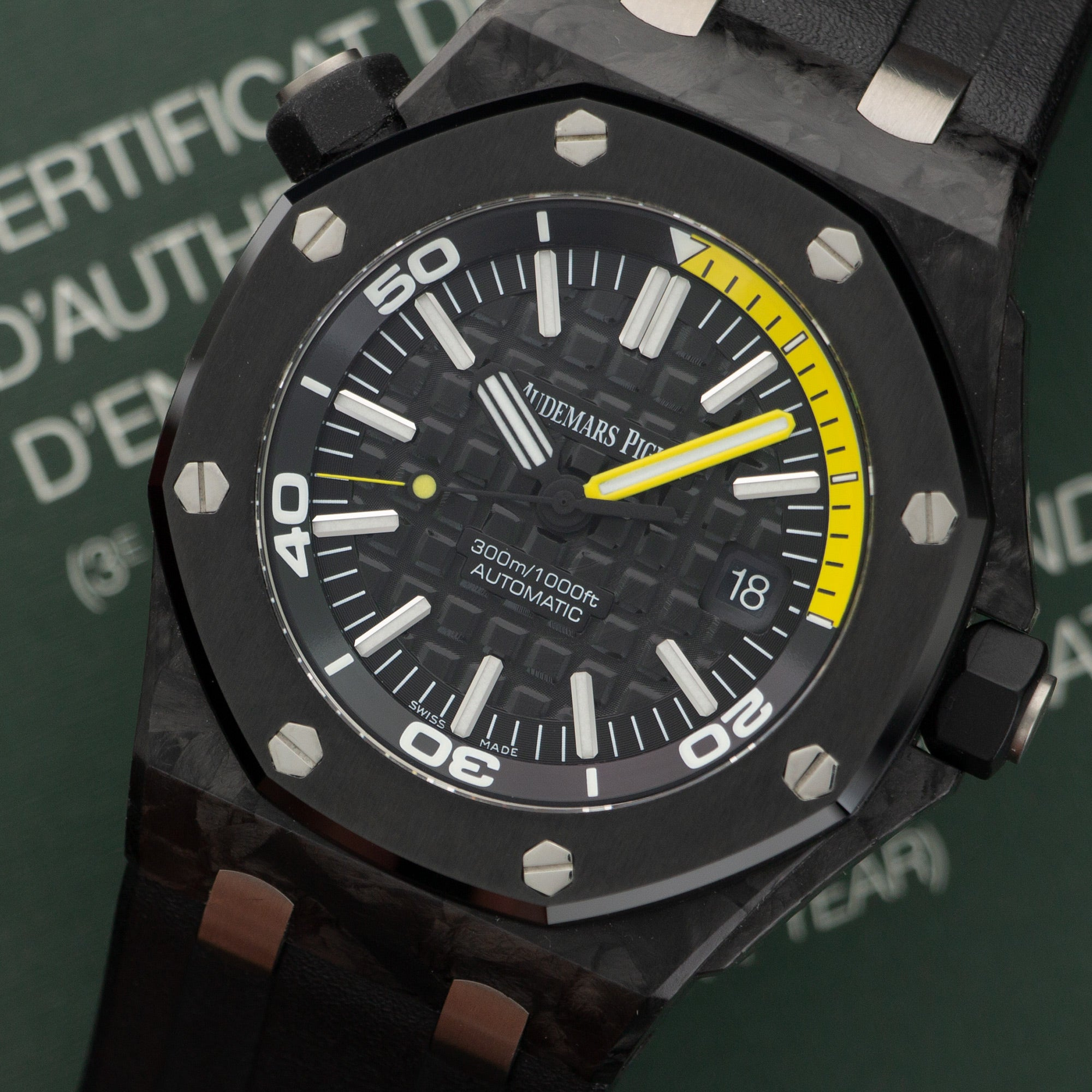 Audemars Piguet Royal Oak Offshore 15706AU.00.A002CA.01 Carbon Fiber  Like New, Worn a Few Times Gents Carbon Fiber Black Waffle Dial with Yellow Accents 42mm Automatic 2014 Black Rubber Box, Manuals, Warranty Card