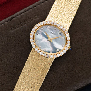 Piaget Vintage 9801 18k YG  Mint Ladies 18k YG Mother of Pearl with Diamonds 28mm Manual 1970s Yellow Gold Bracelet Leather Travel Case