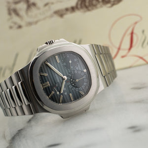 Patek Philippe Nautilus Moonphase 5712/1a Steel  Signs of Average Wear, Original Finish Gents Steel Blue 40mm Automatic 2006 Stainless Steel Bracelet Original Box and Archive Paper