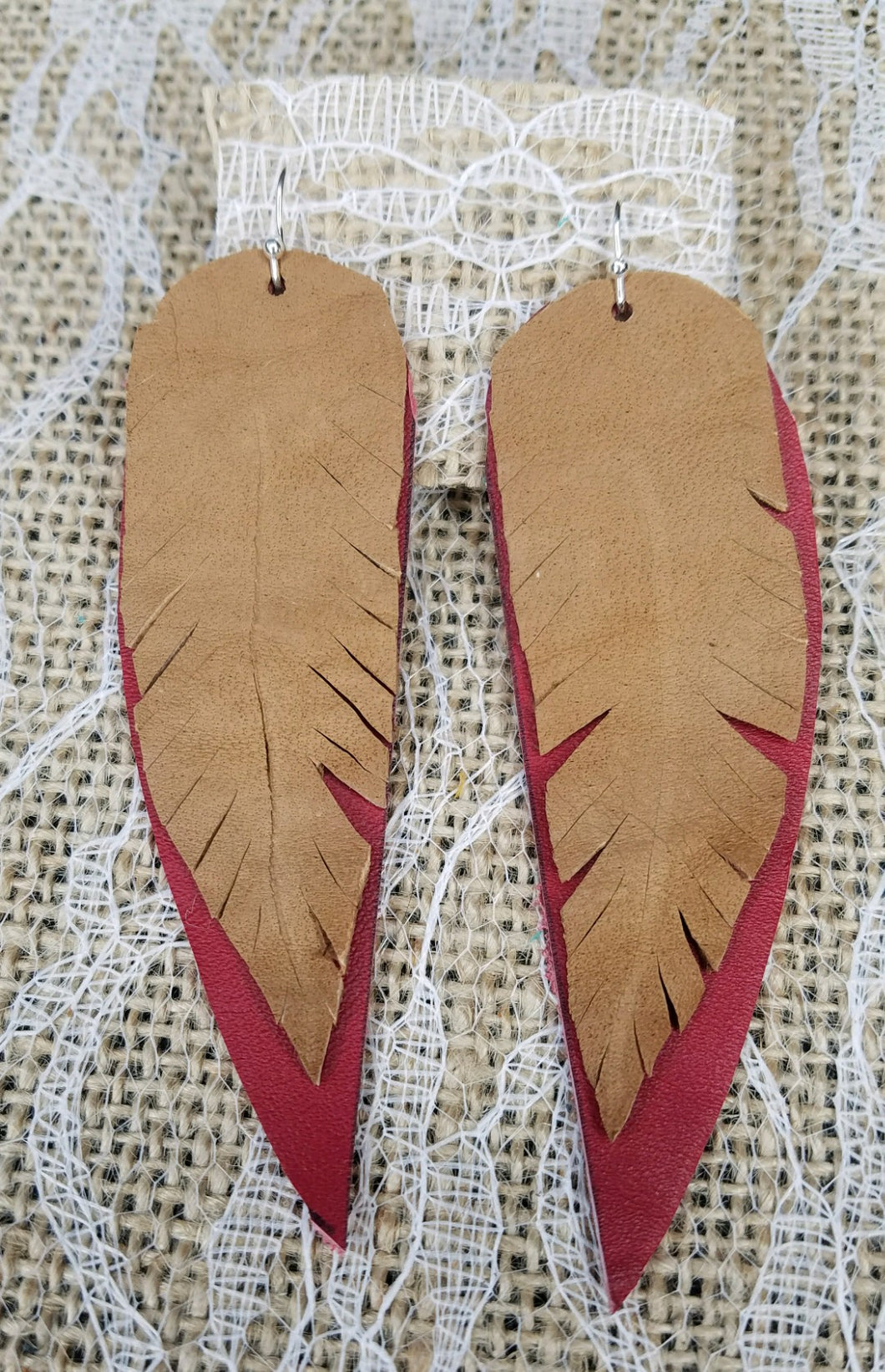Red and tan layered feather earrings