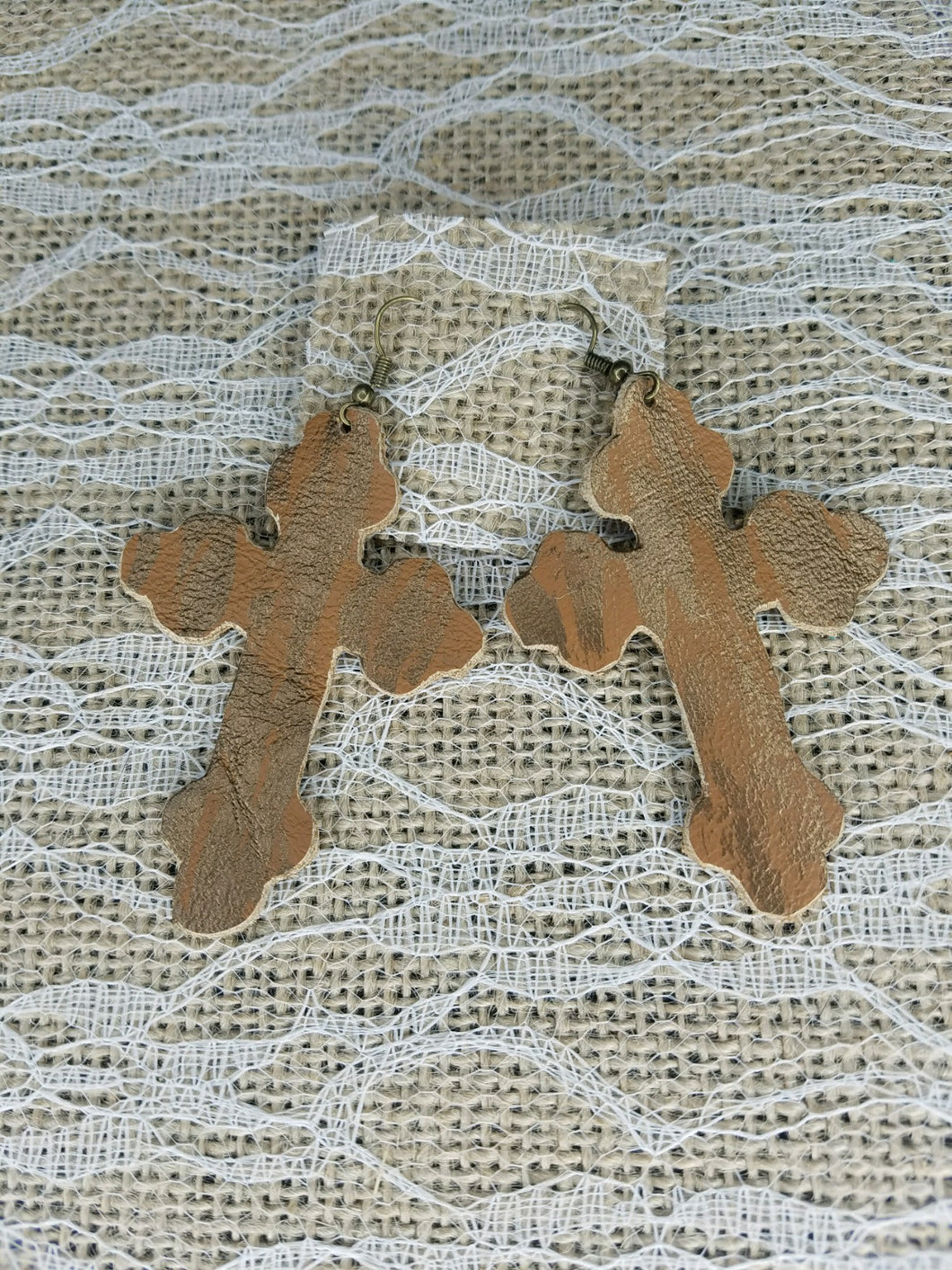 Golden tan leather cross earrings