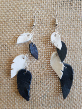 Black and white leather feather earrings