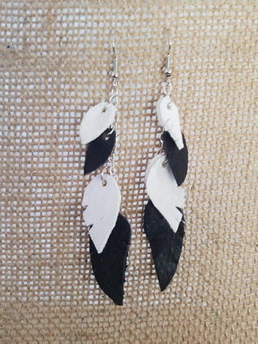 Layered black and white leather feather earrings