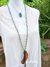 Green beaded feather necklace