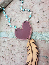 Red heart and feather necklace