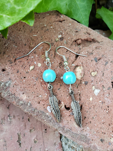 Turquoise beaded feather earrings