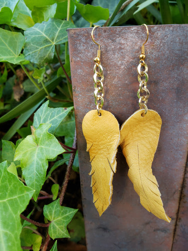Mustard dangling feather earrings