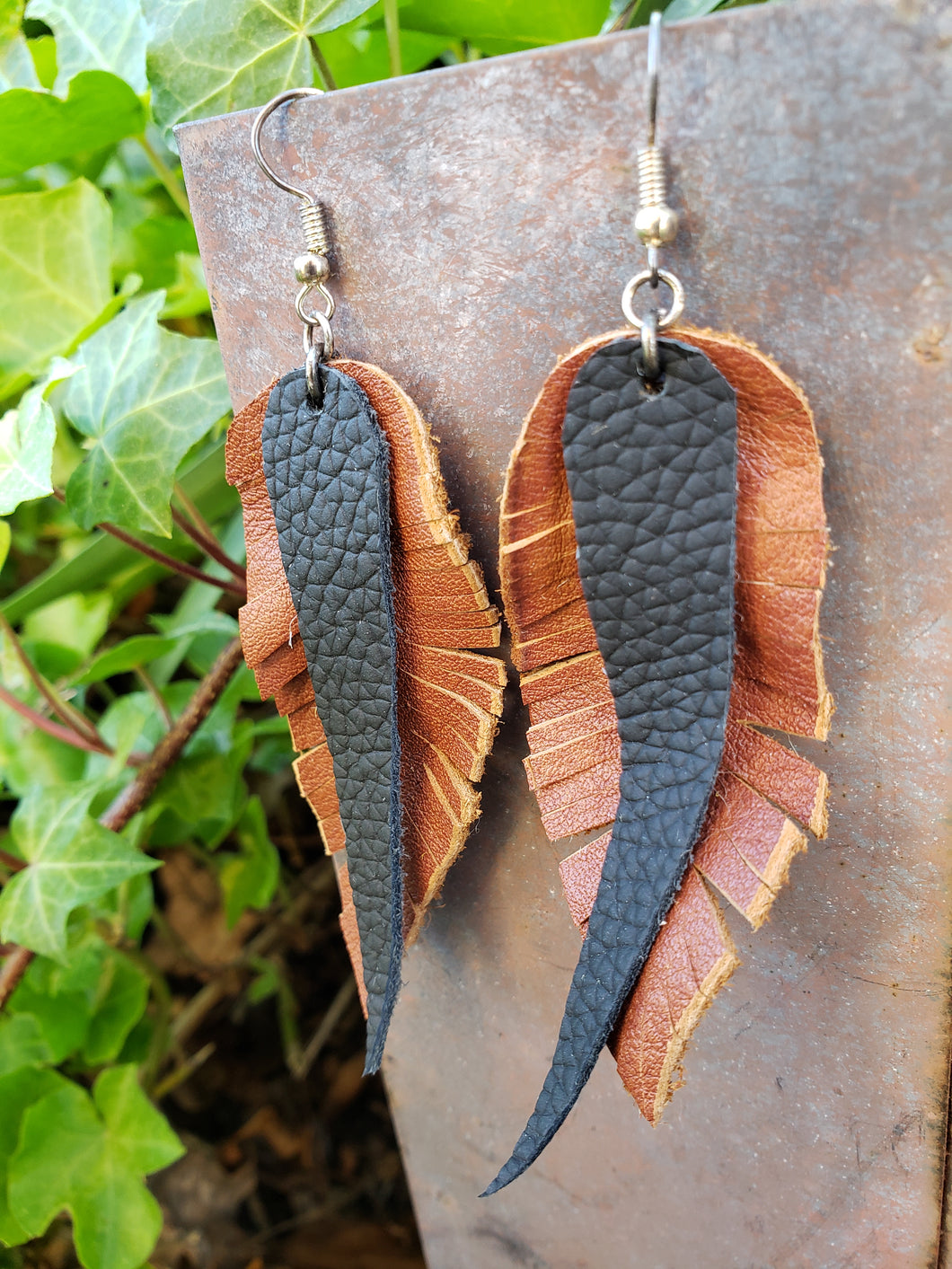 Black and brown leather feather earrings