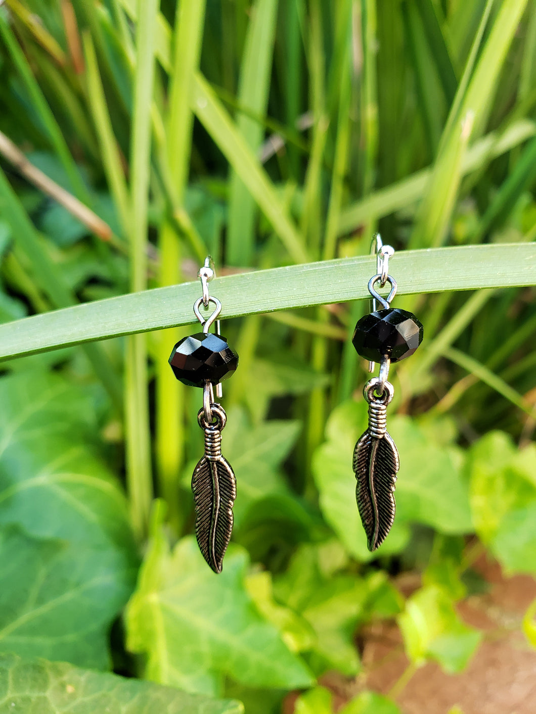 Black crystal feather earrings