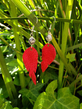 Crimson red beaded feather earrings