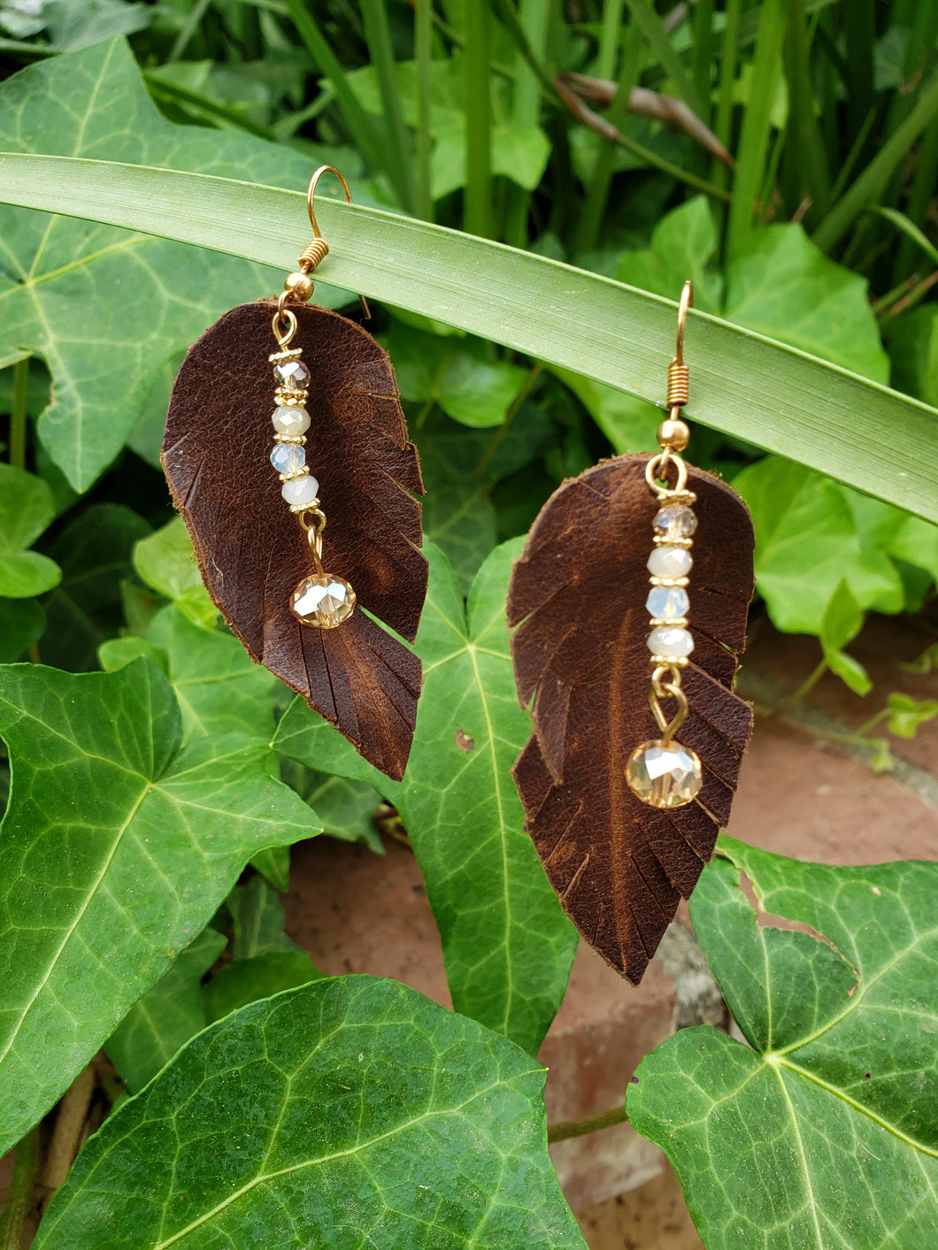 Crystal accent brown feather earrings