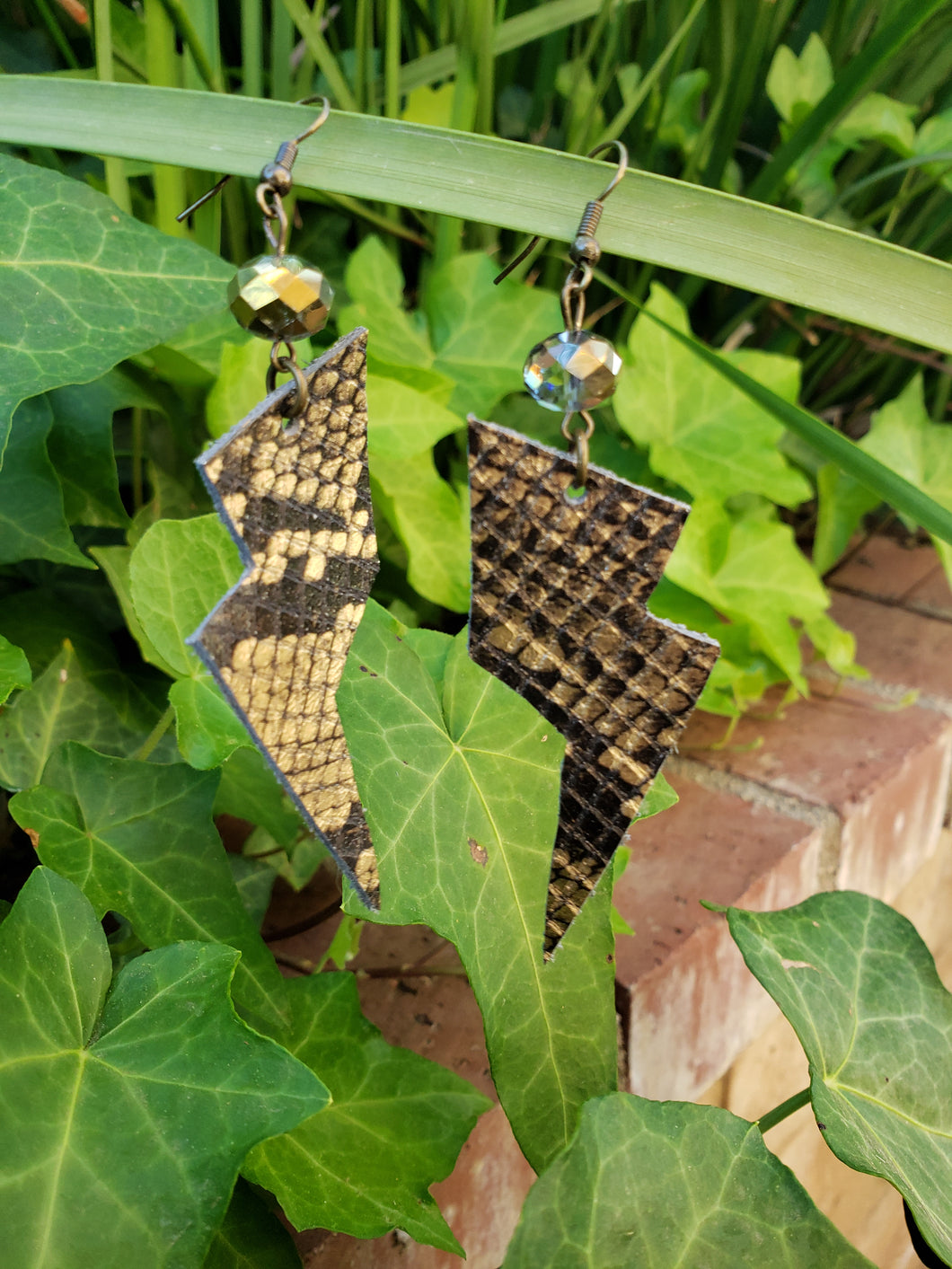 Gold metallic snakeskin lightning bolt earrings