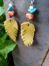 Mustard beaded feather earrings