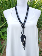 Black feather necklace