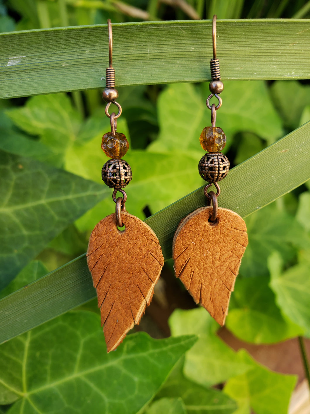 Tan dangle feather earrings