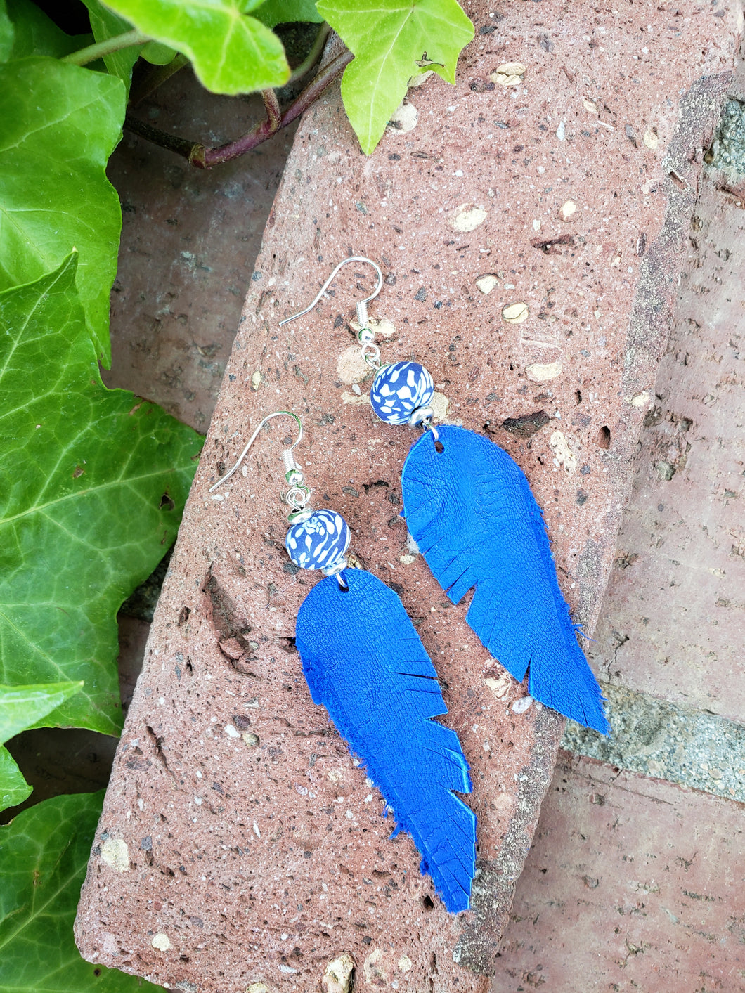 Brilliant blue feather earrings