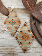 Wildflower tooled leather earrings
