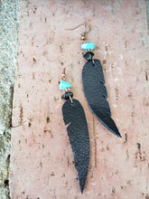 Black leather feather dangle earrings