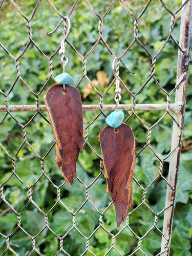 Turquoise accent leather feather earrings 2 inches