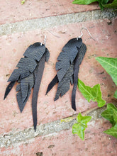 Black layered leather feather earrings