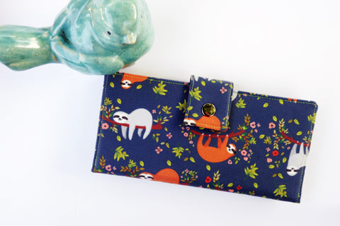 Super Cute Sloths on Navy Floral Background