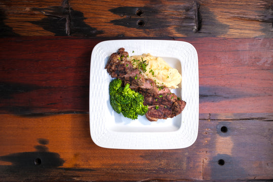 BEEF AND BROCCOLI <small> Sautéed Beef with garlic mashed potatoes. </small>