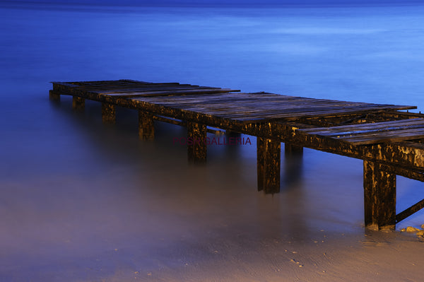 Wooden Pier on Blue Water