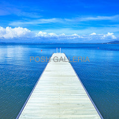 WHITE PIER ON BLUE WATER