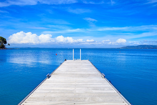 BLUE WATER, WHITE PIER