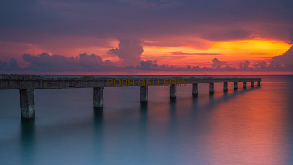 PIER WITH  BRILLIANT RED SKY SUNSET