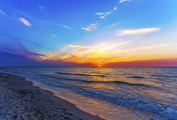 COLORFUL SUNSET OVER CALM OCEAN