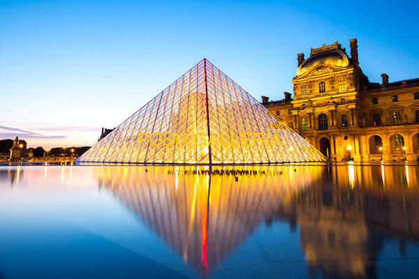 PYRAMID IN FRONT OF LOUVRE MUSEUM IN PARIS