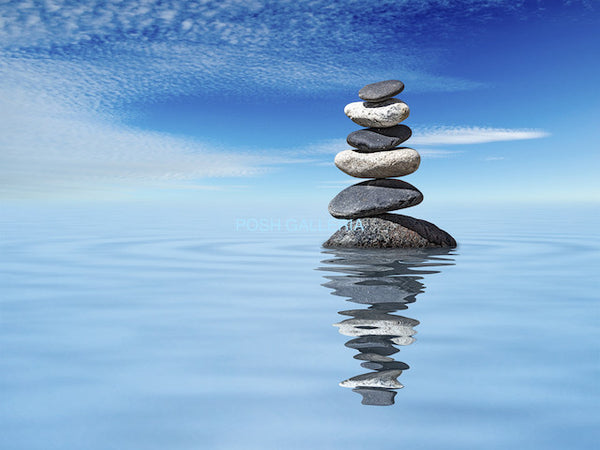 STONES RISING FROM WATER TO BLUE SKY