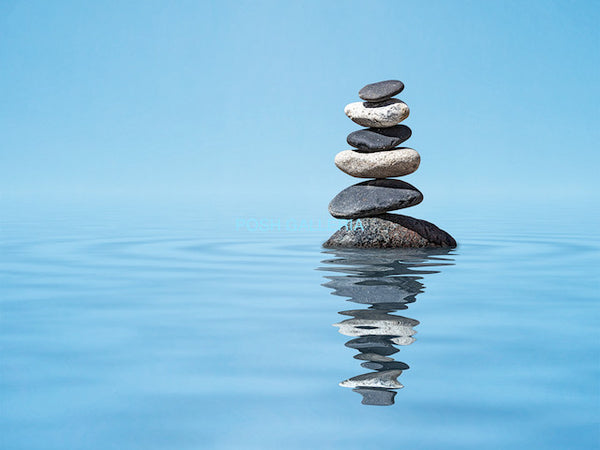 STONES RISING FROM CALM BLUE WATER