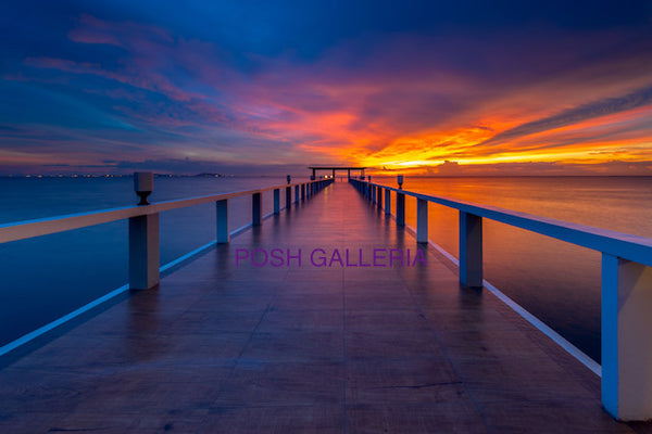 PIER INTO PURPLE RED BLUE SKY HORIZON