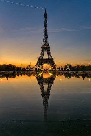 PARIS EIFFEL TOWER ON REFLECTION OF WATER AT SUNSET