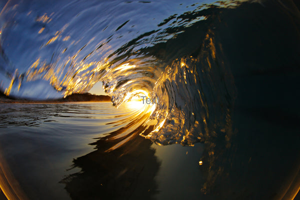 Perfect Wave Captures Sunset