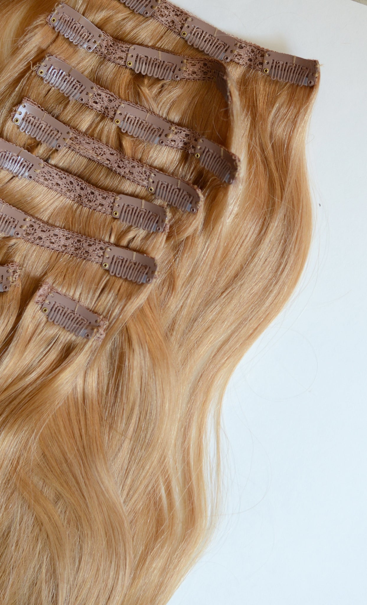 Strawberry Blonde Clip-In Hair Extensions - 20 inches / 200 gram full head set of 100% Remy clip-in human hair extensions