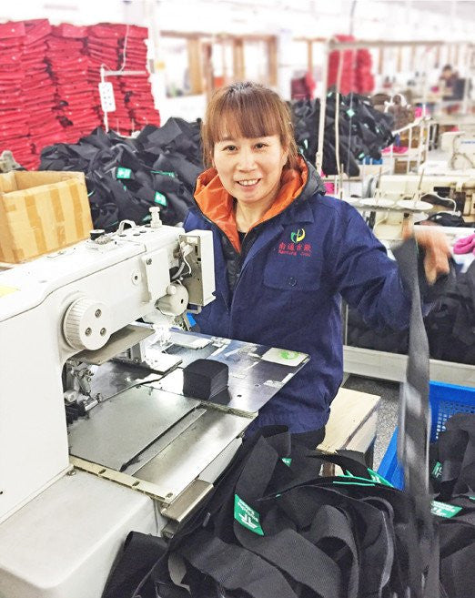 worker sewing at factory