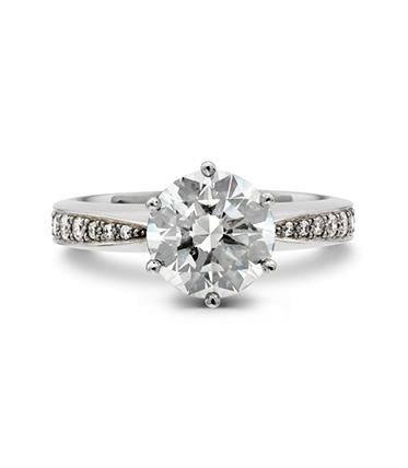 Tapering bead set engagement ring