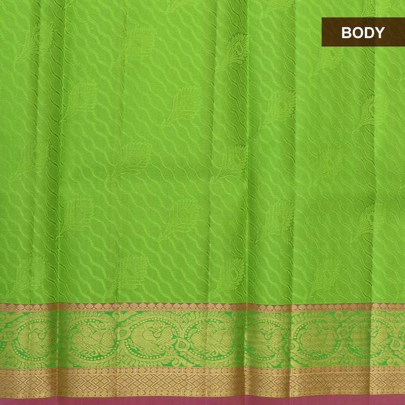 Pure silk pavadai material grass green and pink with overall self emboss and golden zari peacock border for 6 to 10 years