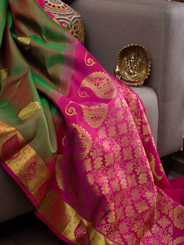 Kanjivaram Silk Sarees Dual shade of Moss Green with Leaf Buttas and Leaf Border