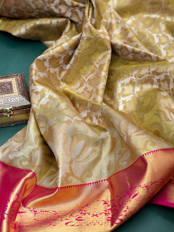 Pure Kanjivaram bridal silk saree golden tissue with floral emboss and contrast pink korvai border