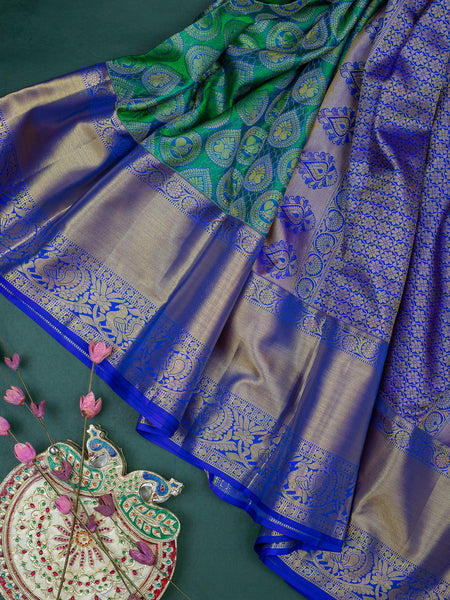 Pure Kanjivaram silk saree with peacock green and blue contrast korvai border and full zari embossed peacock and paisley buttas